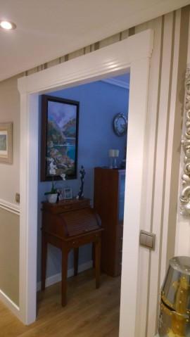 Forrado marcos puerta con capitel recto