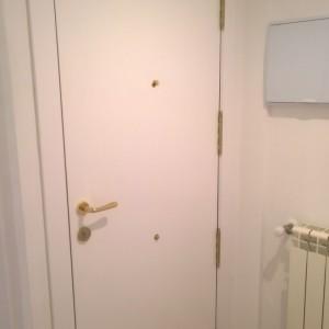 Panelado puerta de entrada